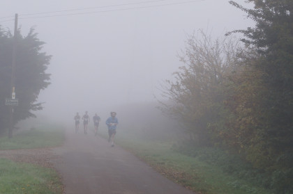 lode half marathon runners in the mist